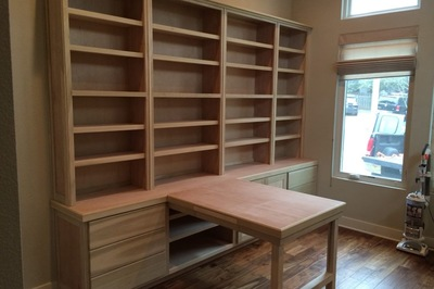 A built-in custom shelving unit will perfectly fit a home and can include amentities like desks and storage.