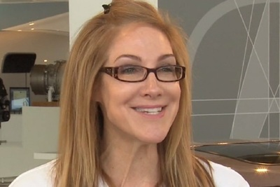 Lara Harrington recalls she enjoyed working in the garage with her dad.