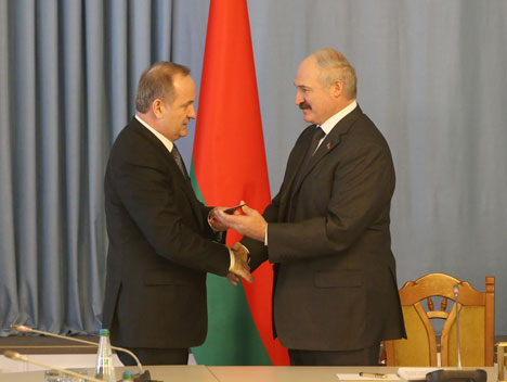 Belarus President Alexander Lukashenko, right, recently spoke at a ceremony at which he named the new chairman of the National Bank, Pavel Kallaur.