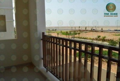 The balcony of this one bedroom and one bathroom apartment in Al Ghadeer shows the water in the distance.