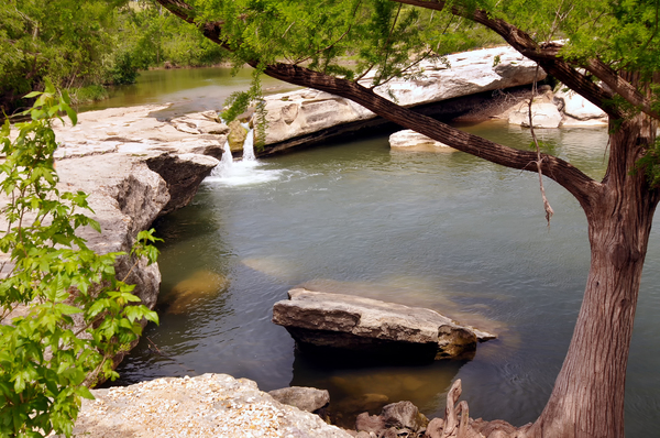 McKinney Falls State Park is very close to Del Valle and provides natural beauty