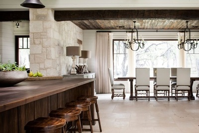 Wood paneling on the ceiling plays off of the traditional architecture of a home.