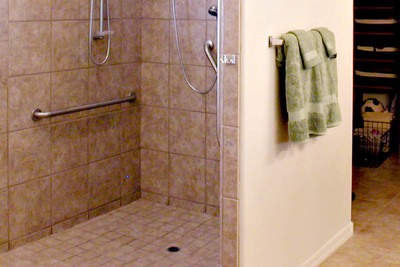 Strategically placed rails can help the elderly avoid injuries in the bathroom.