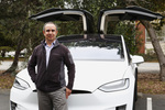 Miguel Casillas, founder and executive director of SV Links, with his Tesla X that he rents out using Turo.