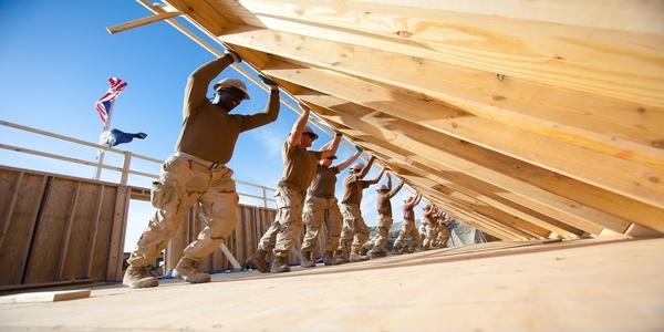 Large men working