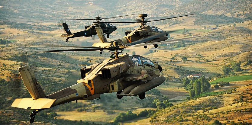 Apache helicopters of the Israeli and Hellenic Air Forces fly together in a joint aerial exercise.