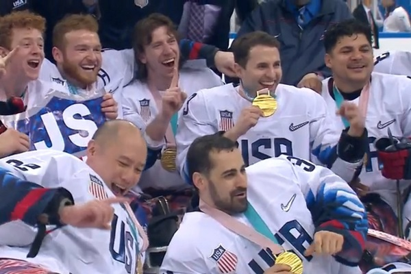 Paralympic team USA sled hockey team shortly after winning gold in South Korea on Monday. Josh Misiewicz is seated in the middle of the the top row.