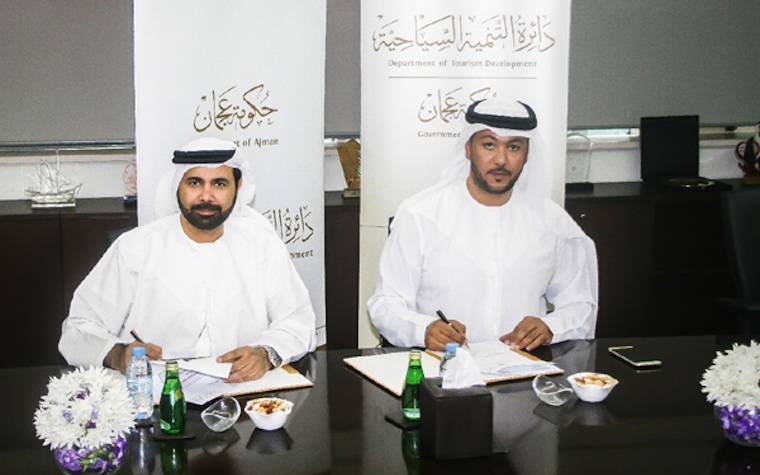 Faisal Al Nuaimi, General Manager of ATDD (right) signs the new cooperative agreement with Ali Issa Al Nuaimi, Director General of Ajman DED.