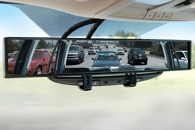 This mirror attachment provides a 180-degree field of view of the road.