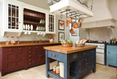 If a home is not built with a kitchen island, a stand-alone unit can be brought in to fill the void.