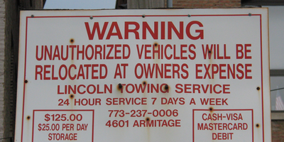 Medium lincoln towing sign