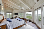 Enjoy the serene setting and stunning views from the home's enticing wrap-around balcony.