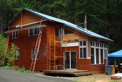While it holds the appearance of aged wood, this cladding is actually made from durable fiber cement siding.