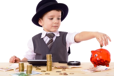 Medium shutterstock boy countg coins redpiggybank