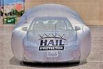 This hail protection system basically creates an air bag over the car.