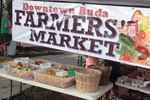 The bustling Buda Farmers Market supports sustainability with fresh affordable produce every March through October.