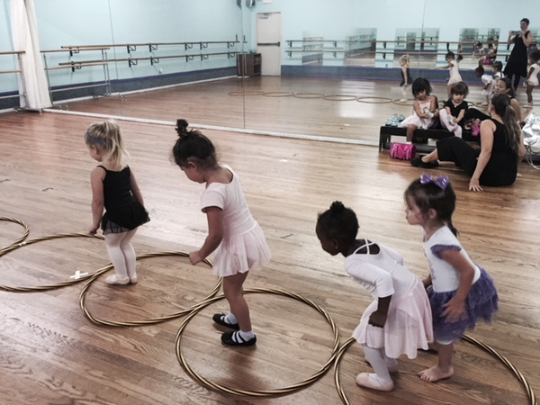 Tykes tumble, improvise and learn at this dance, theater and gymnastics school in Windsor Park.