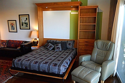 By simEmerging from the wall, a Murphy bed turns an office into a guest room.