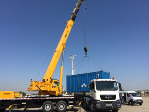 The HEU container is loaded onto a truck in Uzbekistan.