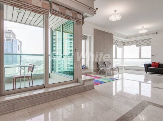 A four bedroom apartment with views of Dubai Marina is now available.