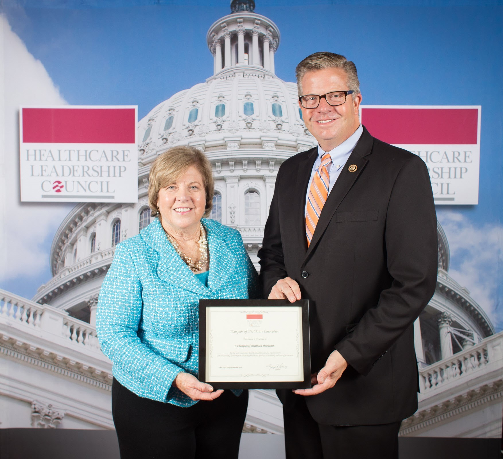 "U.S. Rep. Randy Hultgren (R-Dist. 14) receives the ""Champion of Healthcare Innovation"" award from Healthcare Leadership Council President Mary Grealy."