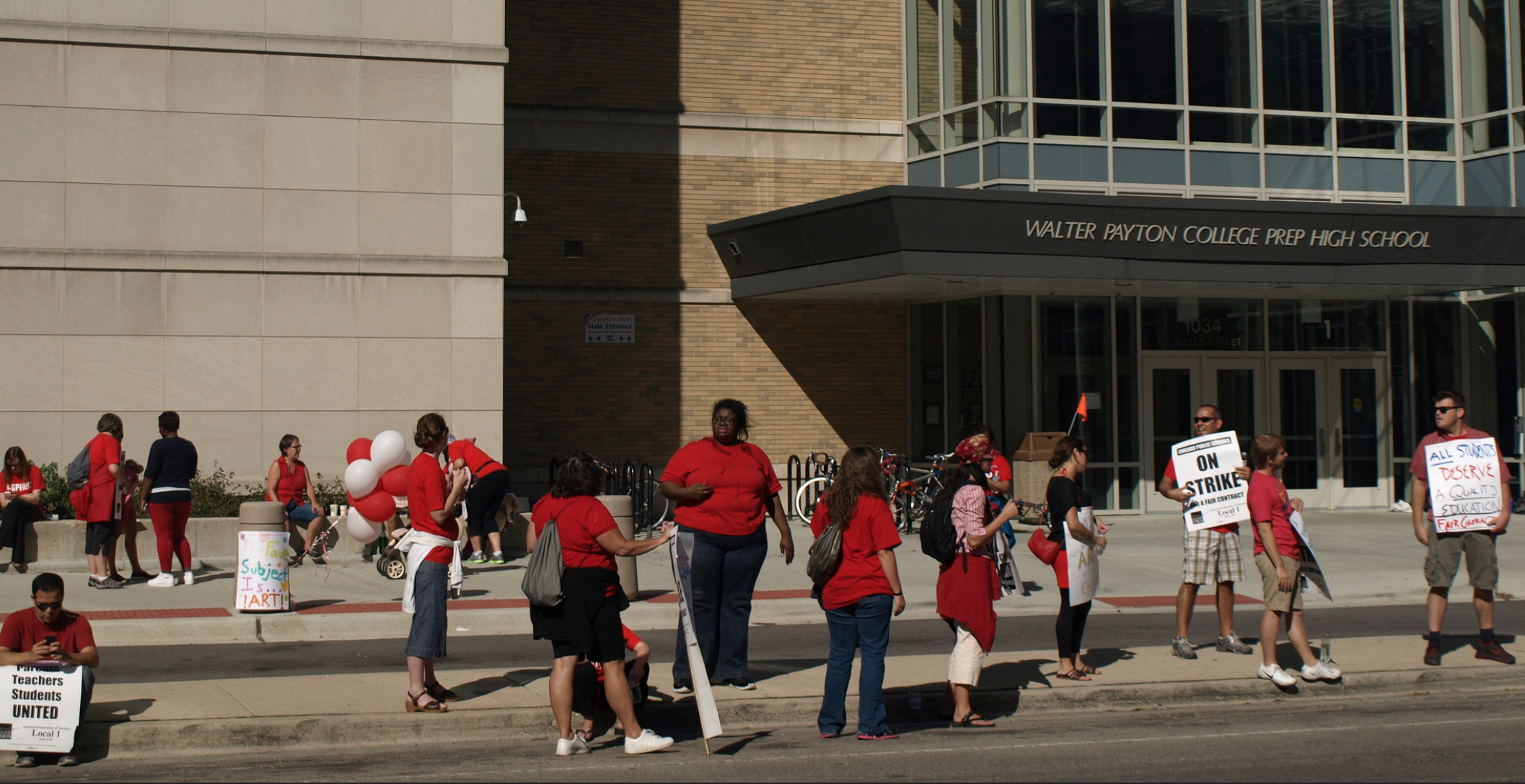 Chicago Public School teachers protest in front of Walter Payton College Prep, 1034 N. Wells St. It cost the equivalent of $44 million to build in 2000.