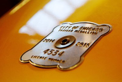 Medium taxicab medallion closeup