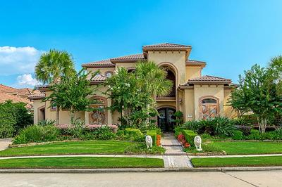 This Mediterranean-style home has Taylor Lake access.