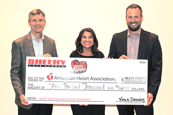 Vince Sheehy of Sheehy Auto Stores (left) with Soula Antoniou and J.P. Wiley of the American Heart Association