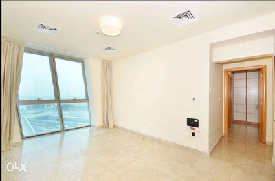 Living space in the available two bedroom apartment in Lagoona at Zig Zag Tower.