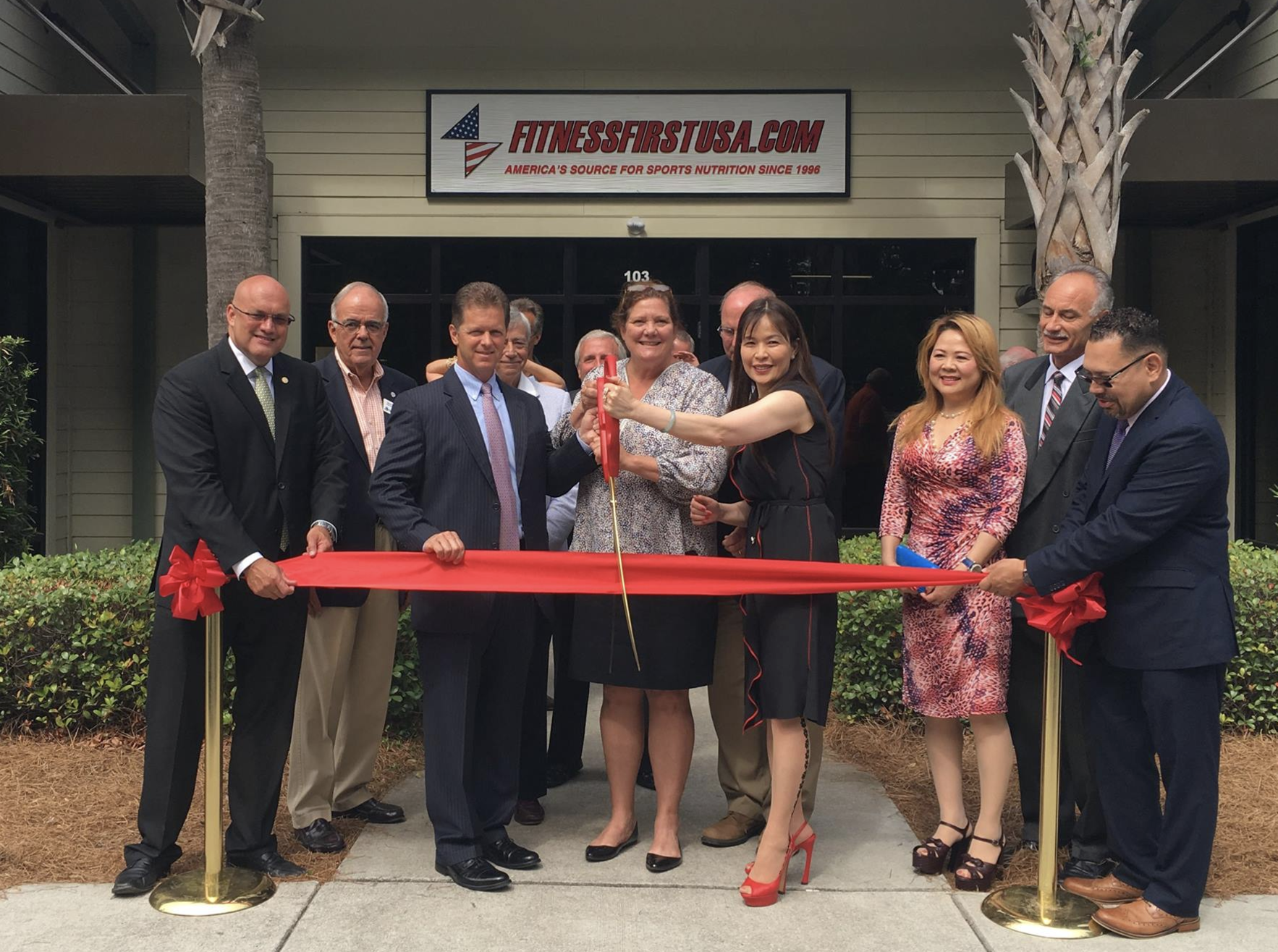 Mt. Pleasant, SC Mayor Linda Page, Town Council Member Mark Smith and others help welcome Fitness First USA to town in a ribbon cutting ceremony held 6/1/17