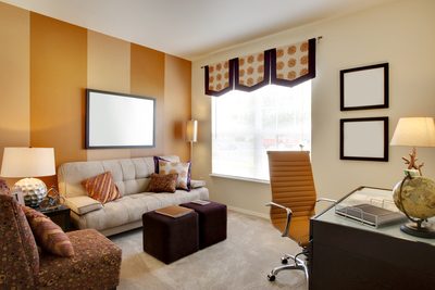 Have a small office or den? Small spaces can be made to feel more spacious with the right colors. Opting for mellow colors such as the shades of orange and crème featured here can help open up the space.