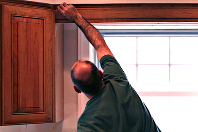 Avoid solvents and abrasives, as well as too much water, when cleaning kitchen cabinets.