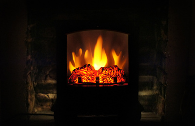 Artificial fireplace inserts can provide heat and ambiance without the clean-up afterward.