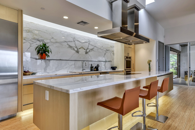 This private home features a sophisticated gourmet kitchen opening to living areas abounding with natural light.