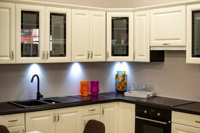 Simple additions like lighting and resurfacing cabinets can make a big impact on the look of a kitchen.