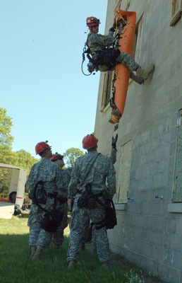 Members of the Wis. and Minn. National Guard take part in a emergency response exercise involving hazardous materials.