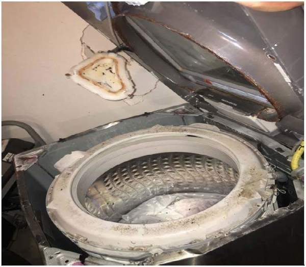 Picture attached to legal documents filed by Plaintiff showing the Samsung washing machines post-explosion.