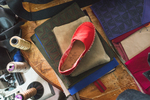 Handcrafted shoes and accessories sales support mothers and fight AIDS in Africa.