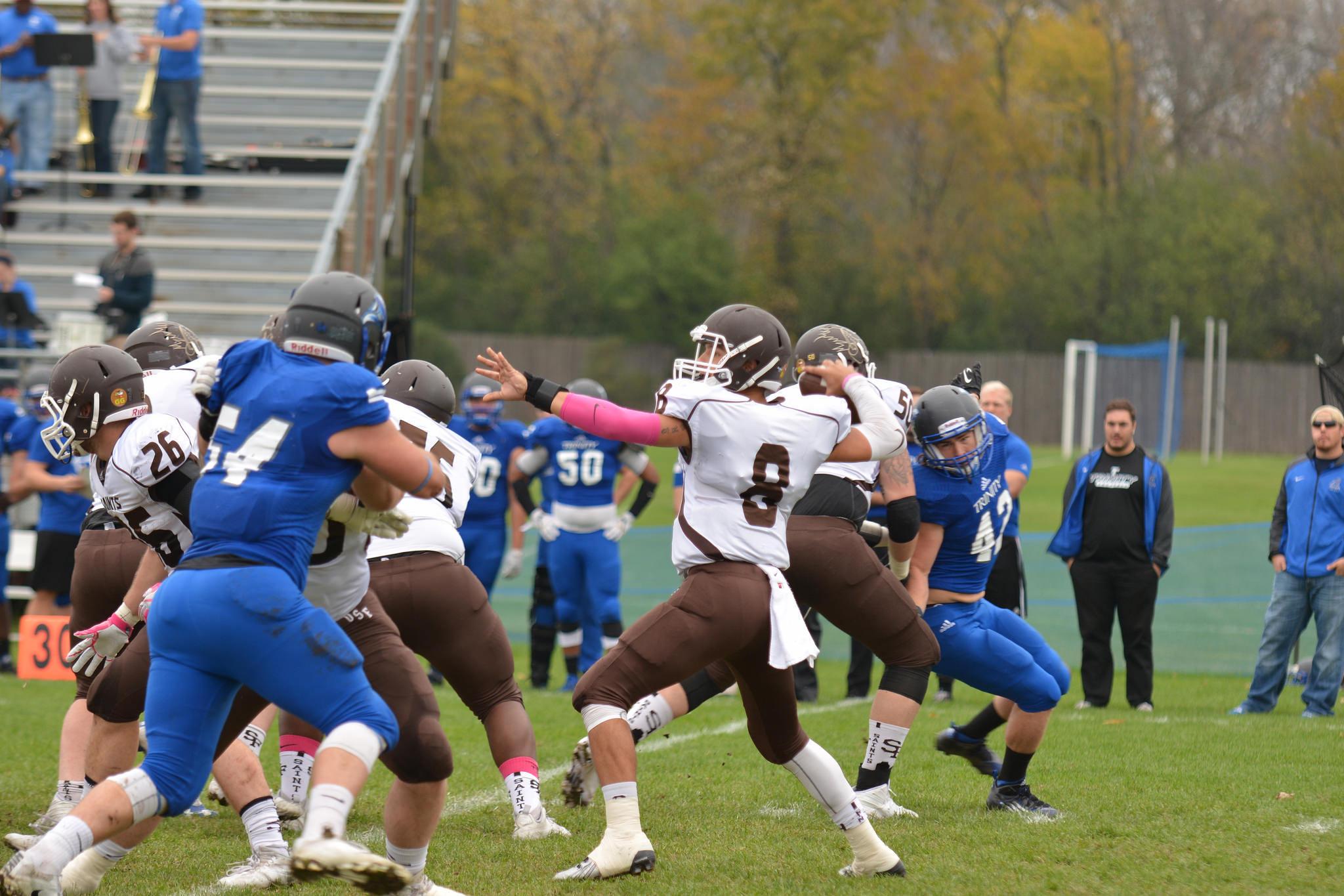 University of St. Francis quarterback Don Butkus throws a pass.