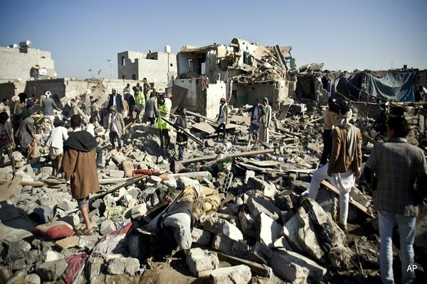 People searching for survivors after Saudi airstrikes near Sanaa Airport, Yemen, on  March 26, 2015.