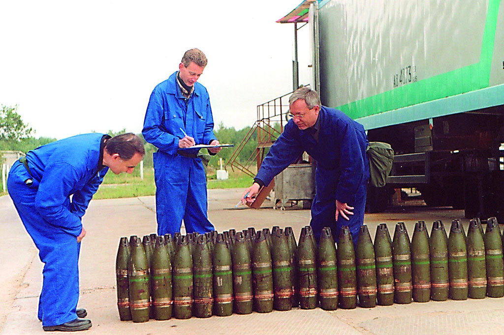Inspectors from the Organisation for the Prohibition of Chemical Weapons (OPCW) inventory a stockpile of 22mm chemical artillery projectiles