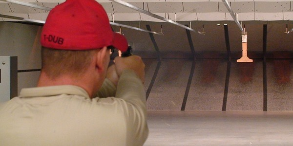 Large 1280px small firearm training at an indoor firing range