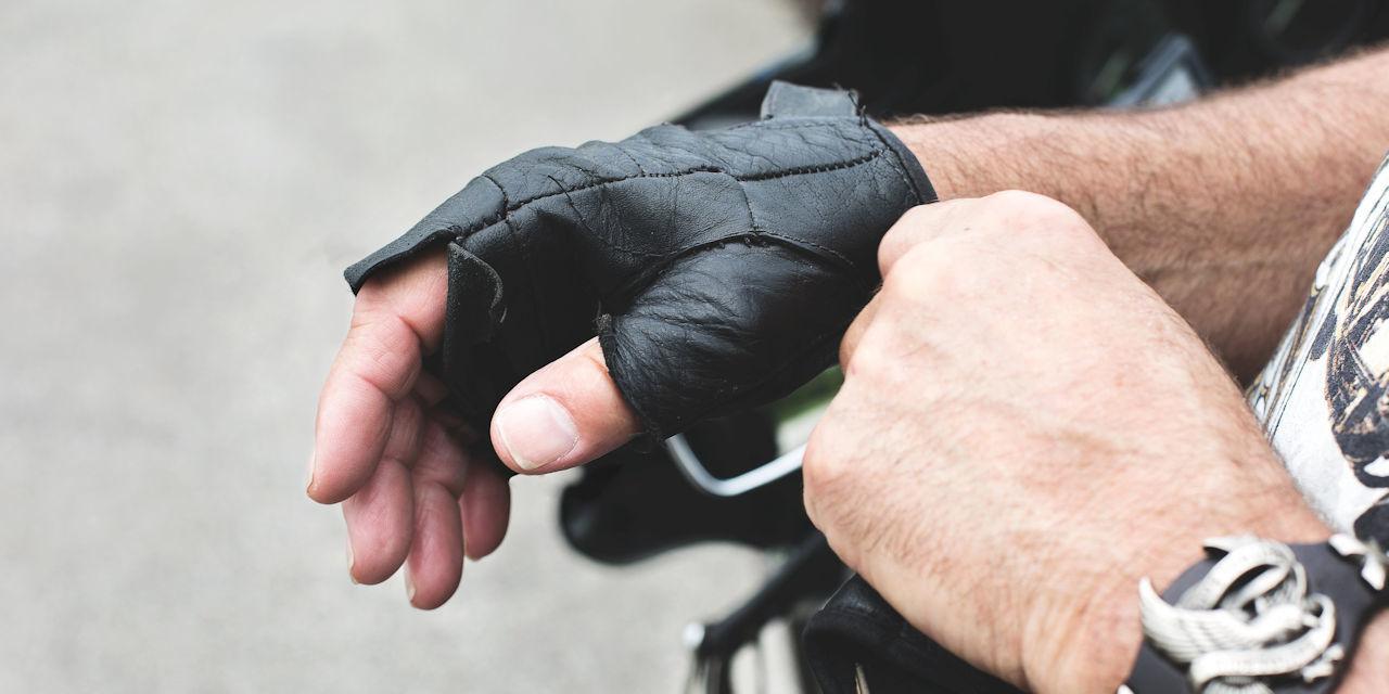 Worn motorcycle gloves 1280x640