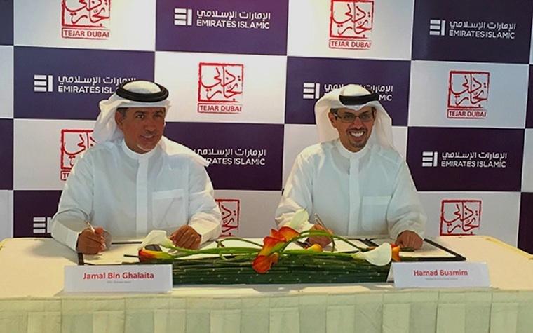 Hamad Buamim (right), Dubai Chamber of Commerce CEO, signs an agreement with Emirates Islamic CEO Jamal Bin Ghalaita.
