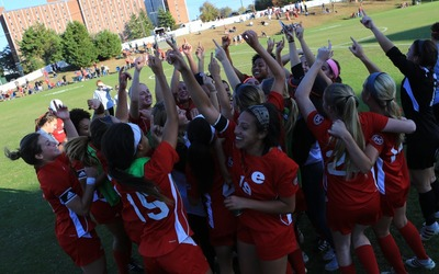 The SIUE women's soccer team celebrates winning the Ohio Valley Conference championship in 2016