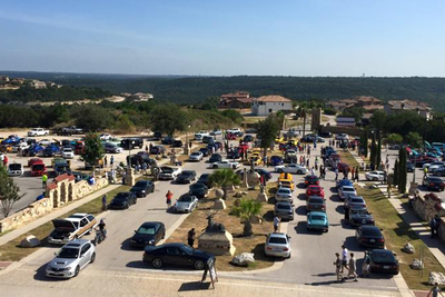 The Cars and Coffee events at the Oasis on Lake Travis draw hundreds of vehicles every month.