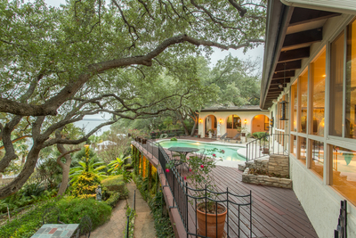 This Spanish Colonial features a lovely outdoor living area.