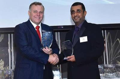 Sami Omar Al Zadjali, right, receives the 2015 Asian Banking and Finance Awards prize for Website of the Year – Oman.