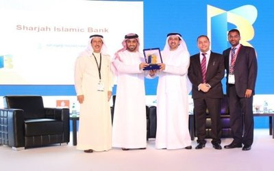 Sharjah Islamic Bank officials accept their award for Best Professional Practices